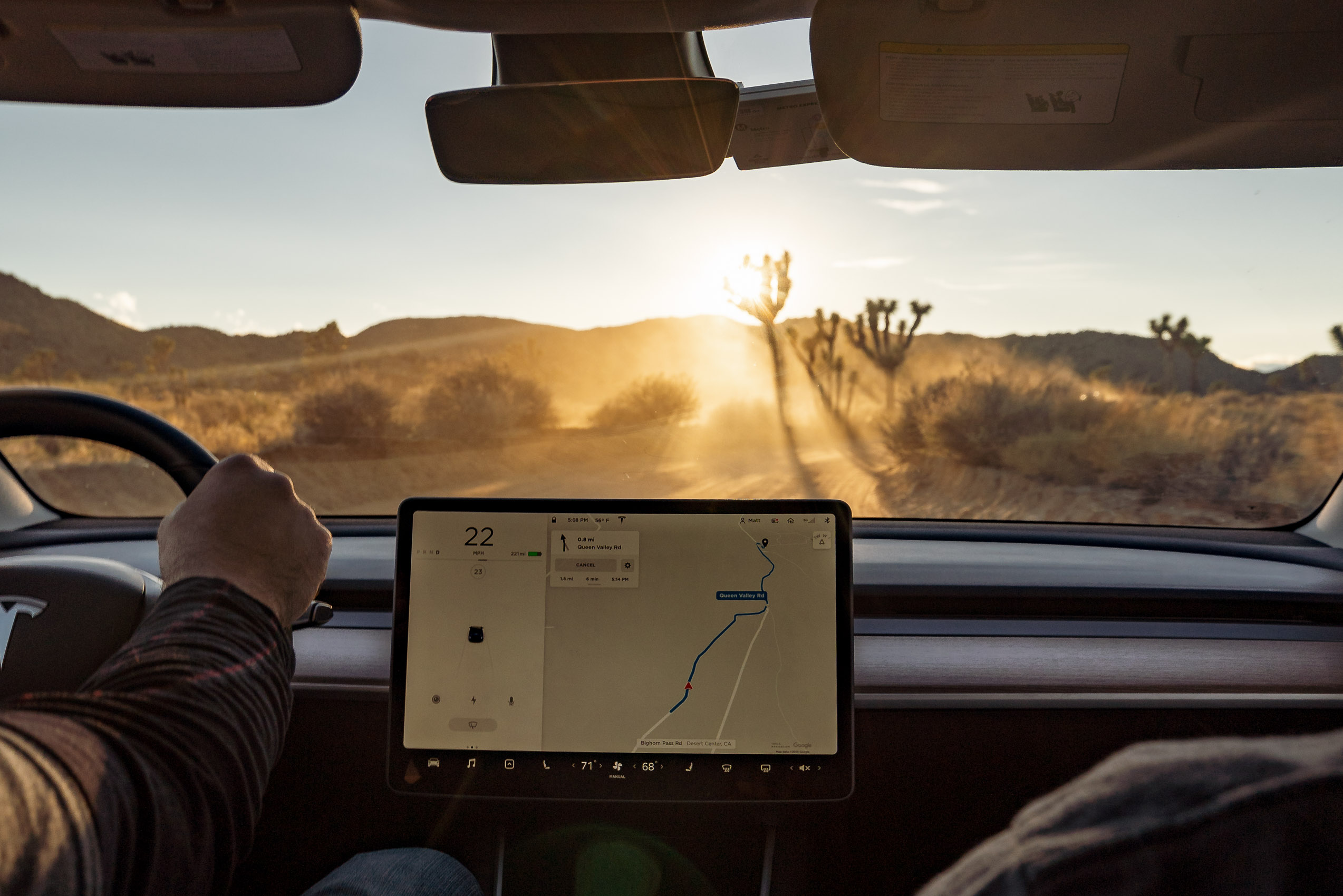 Tesla Driving towards the sun Joshua Tree California Alberta Car Photographer Karl Lee Photography