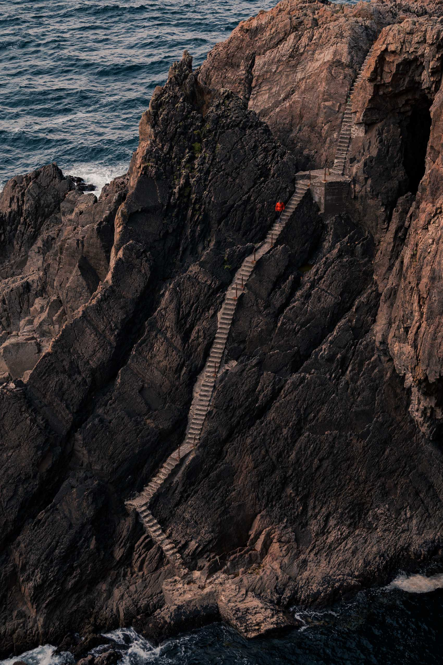 Climbing the steep steps at Arranmore Lighthouse Donegal Ireland